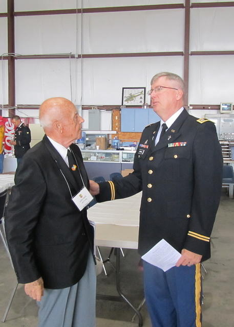 John Kark receiving instruction from Chaplain (CPT) Paul Cartmill