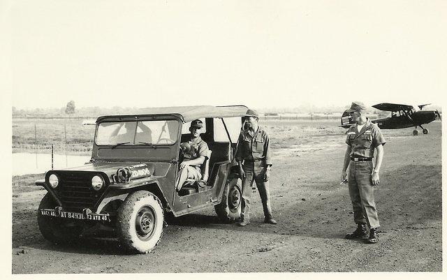 Tan Hiep, Jack Burden driving, Jack Byrnside on right, gas truck driver standing next to jeep