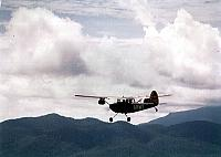 57-2901 flies out over the mountains on a photo-recon mission