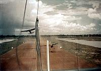 Three plane takeoff from Tan Heip Airfield